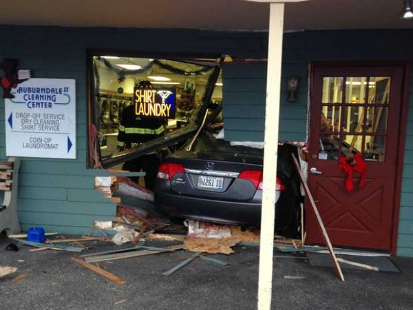 This Honda Civic, driven by Lucienne Samson of Lewiston, crashed through the front of the Auburndale Cleaning Center in Auburn on Tuesday afternoon. The car ended up between a wall and a bank of dryers. Samson was not injured. She told the Sun Journal that she had attempted to stop at the curb in front of the store and the car &quotzoomed&quot forward.