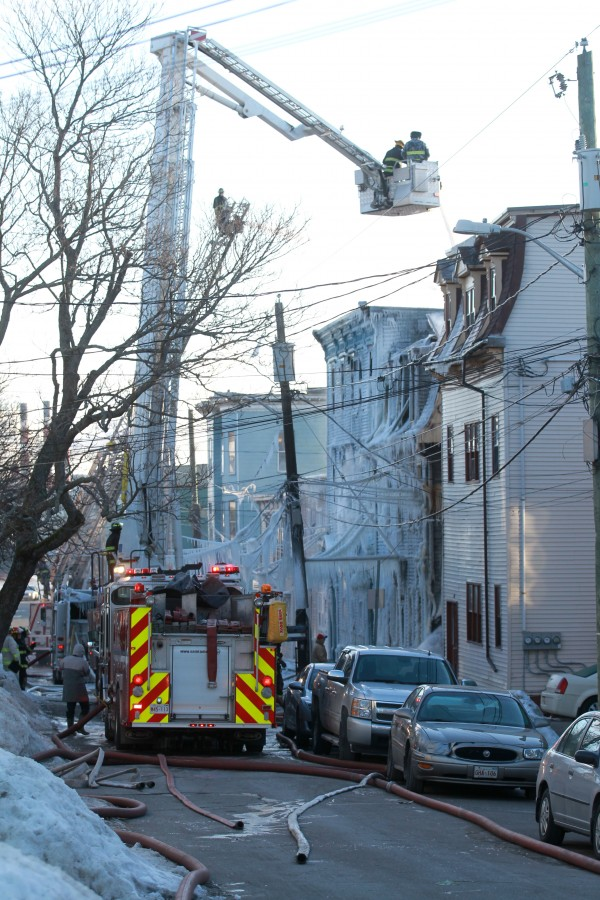 Saint John Fire crews continue to fight a fire that broke out on Mecklenburg Street well into Sunday morning. The fire, which started around 2 a.m., destroyed two buildings displacing approximately 16 residents.