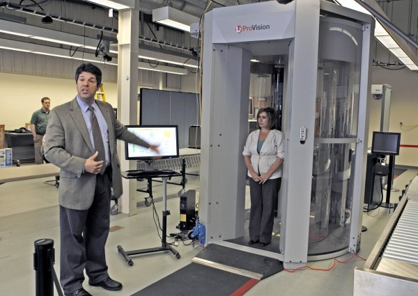 TSA scientist Josh Rubinstein (left) demonstrates the full body scanner with help from technician Nancy Gilles during a tour of the Transportation Security Laboratory near Atlantic City, New Jersey in 2010.