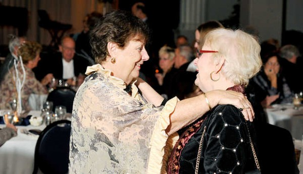 Rita Dube (left), former Franco-American Heritage Center executive director, talks with her longtime friend, Angela Murphy of Lewiston, during Dube's retirement party in Lewiston on Saturday, Jan. 12, 2013.