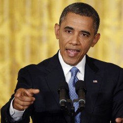 President Barack Obama takes questions from reporters during a news conference at the White House in Washington on January 14, 2013.