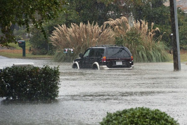 A car sits in water after a road was flooded by rain from Hurricane Sandy in Virginia Beach, Va., on October 29, 2012.