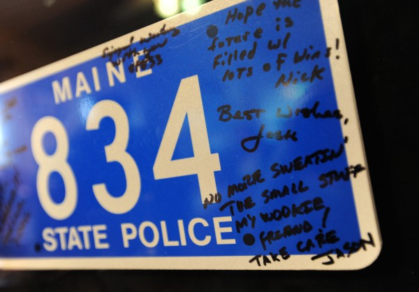 Friends and colleagues signed a tag of Phil Pushard's trooper car number for a retirement gift.