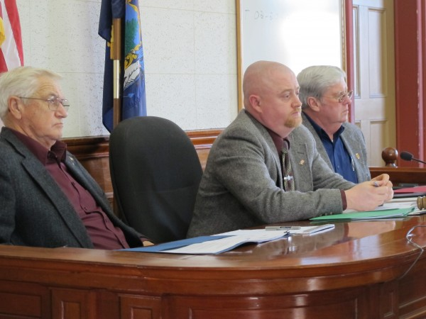 Washington County commissioners (from left) Vinton Cassidy, Chris Gardner and John Crowley listen during deliberations Thursday on Sheriff Donnie Smith's allegations that two of his jail employees mismanaged funds from an inmate benefits account and should be fired. From left are commissioners Vinton Cassidy, Chris Gardner and John Crowley.