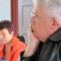 Cpt. Robert Gross, (foreground) the Washington County jail administrator, and Sgt. Karina Richardson, the jail's clerk, listen to testimony Jan. 17, 2013, during a hearing before the Washington County commissioners. Both Gross and Richardson were fired as a result of the hearing.