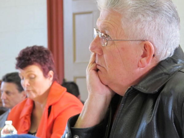 Cpt. Robert Gross, (foreground) the Washington County jail administrator, and Sgt. Karina Richardson, the jail's clerk, listen to testimony Thursday afternoon during a hearing before the Washington County commissioners. Sheriff Donnie Smith accused his two jail employees of mismanaging funds from an inmate benefits fund and asked that they be fired.