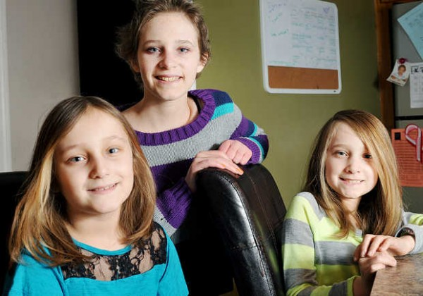 Jordan Flynn (center) and her 8-year-old twin sisters Jorja (left) and Julia have Fanconi anemia, a rare genetic blood disorder that destroys bone marrow.