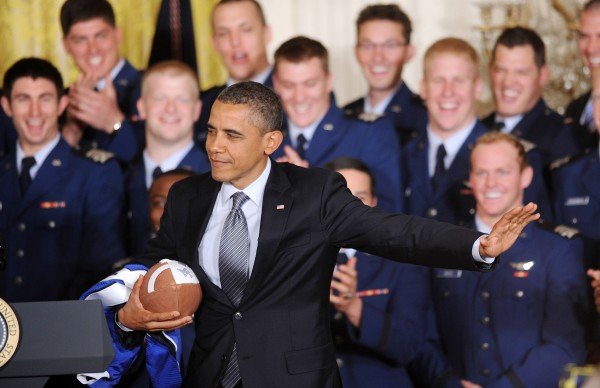 President Barack Obama strikes a pose as he awards the Commander-in-Chief Trophy to the Air Force Academy football team on Monday, April 23, 2012, at the White House in Washington, DC.