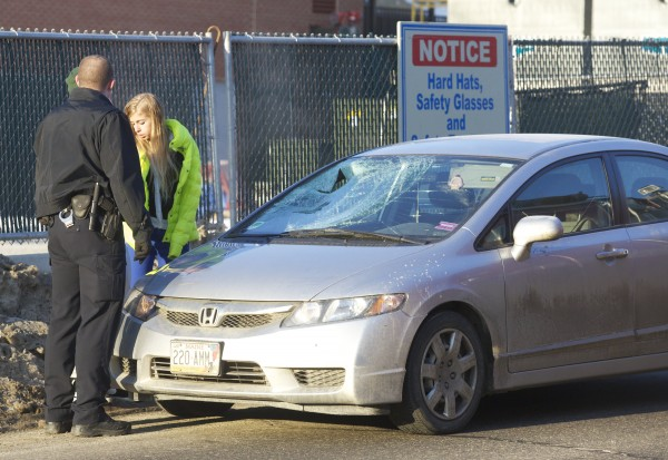 Police investigate the scene where a pedestrian was struck by a passenger car Tuesday morning, Jan. 29, 2013 on Buck Street in Bangor.