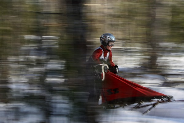 Lucky Carter of Penacook, N.H., gets a fast ride throughout the woods during a junior three-dog race Sunday, Jan. 6, 2013, at the New England Sled Dog Races in Westbrook.