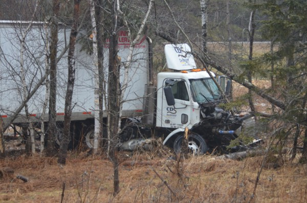 A tractor-trailer sits in the median along Interstate 95 near the Pittsfield and Palmyra town lines on Thursday, Jan. 31, 2013. The driver was uninjured.