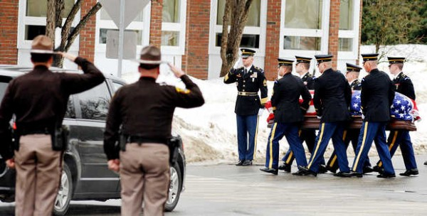 Pallbearers carry the casket of Lt. Col. Michael Backus into the Einar A. Olsen Memorial Student Center at the University of Maine at Farmington on Sunday.