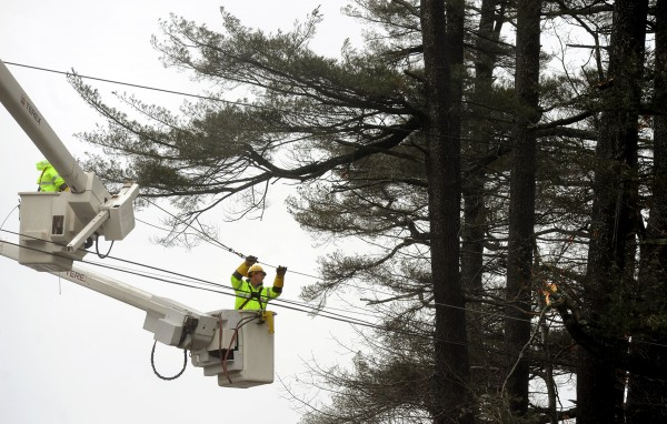 A Bangor Hydro crew works on repairing a downed power line on the Pierce Road in Brewer Thursday morning. Bangor Hydro had more than 8,600 outages from the storm that brought strong wind gusts Wednesday night into Thursday morning.