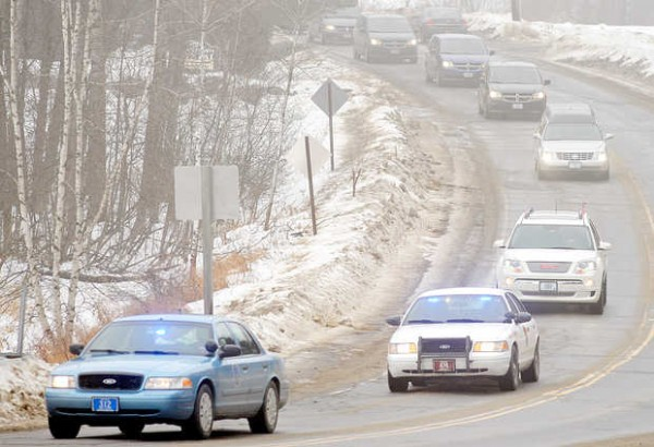 The funeral procession for Lt. Col. Michael Backus winds its way through East Wilton on Sunday.