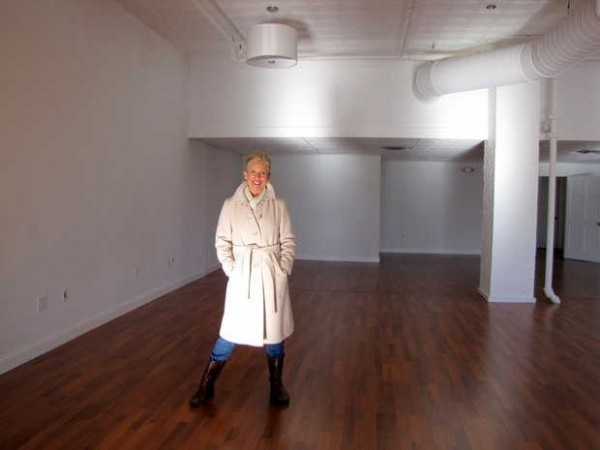 Sallie Tyler stands Thursday, Jan. 3, 2013 in a portion of the space where she will soon open The Paper White Room for events and parties over Calico Patch in downtown Farmington.