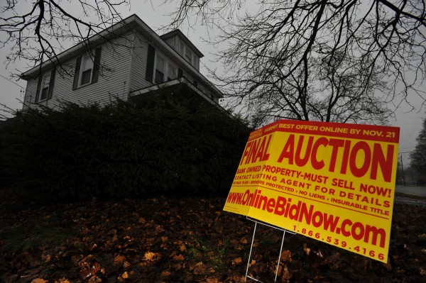 An auction sign in front of a home on Bangor's west side in November 2010.