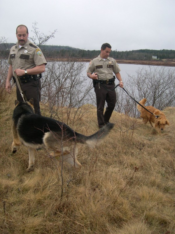 Washington County Sheriff Donnie Smith (right), with Ginger, and Chief Deputy Mike St. Louis, with Kliff, work together in 2004, when Smith was a sergeant and St. Louis was a deputy. Smith fired St. Louis on Friday.