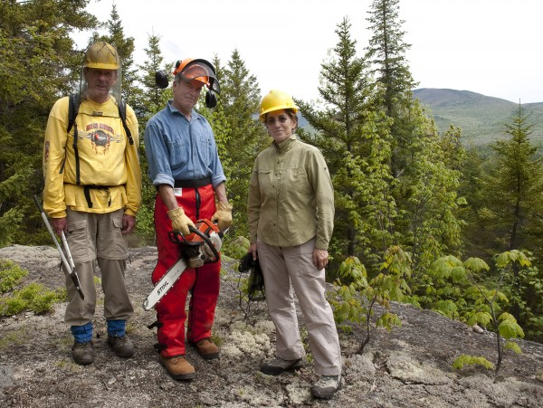 Friends of Baxter State Park members Chris Brown (from left) and Doug Rich join the organization's president, Barbara Bentley, to volunteer their time to clear blowdowns on the Frost Pond Trail in Baxter State Park in May 2009.
