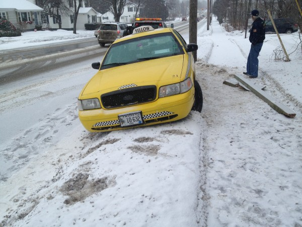 This taxi ran into a sign after swerving to avoid a car that slid into the intersection of Union Street and Longrale Park in Bangor on Wednesday morning.