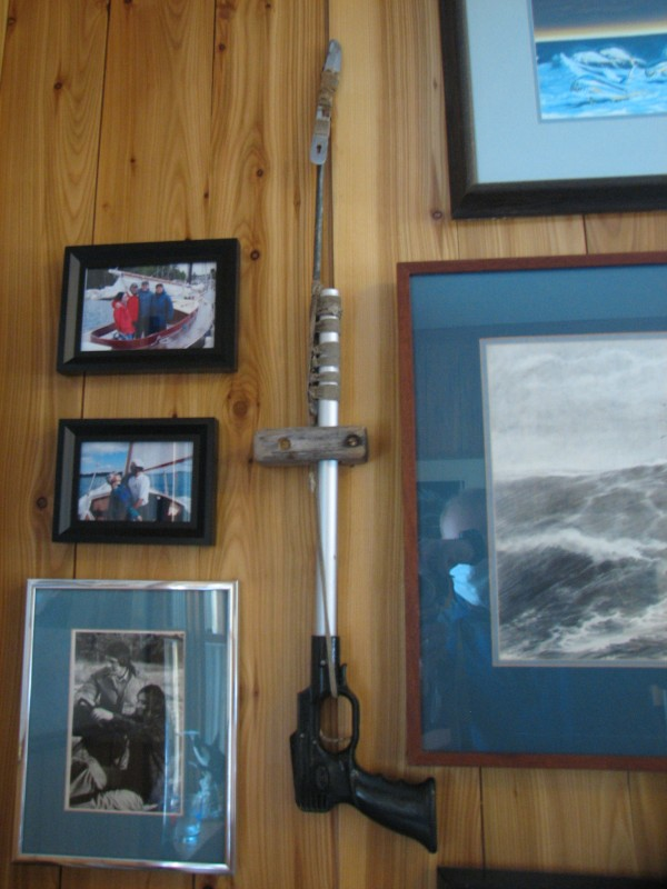 The spear gun Callahan used while adrift in the Atlantic Ocean, complete with a point improvised from a camping knife, is mounted on a wall in the study of his home in Lamoine.
