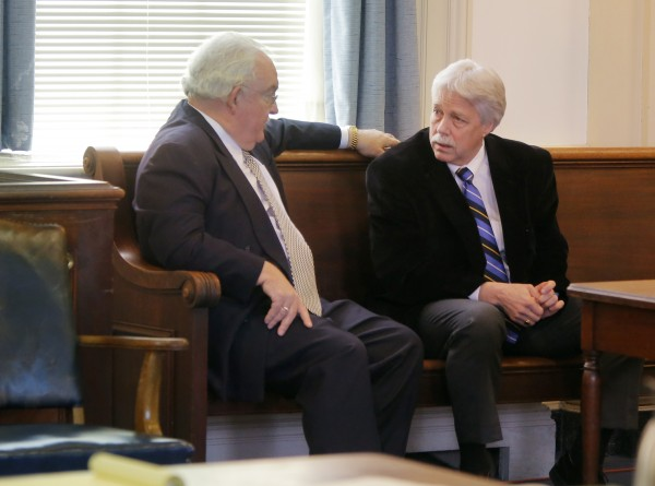 Mark Strong (right) talks with his attorney Dan Lilley after Justice Nancy Mills dropped 46 charges against Strong at York County Superior Court in Alfred on Thursday, Jan. 24. Strong still faces 13 counts.