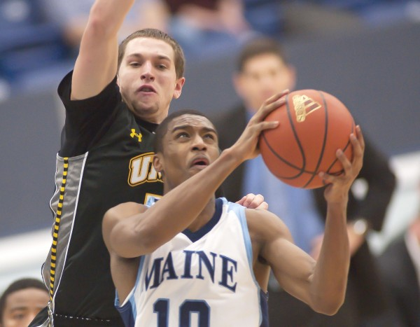 UMaine basketball player Shawn Lawton (10) drives to the hoop under the arm of UMBC player Joey Getz (5) in the second half of their game in Orono on Saturday, Jan. 5, 2013. UMaine defeated the UMBC Retrievers 81-66.