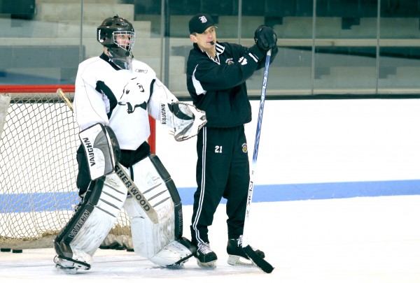 Bowdoin College men's hockey coach Terry Meagher on the ice.