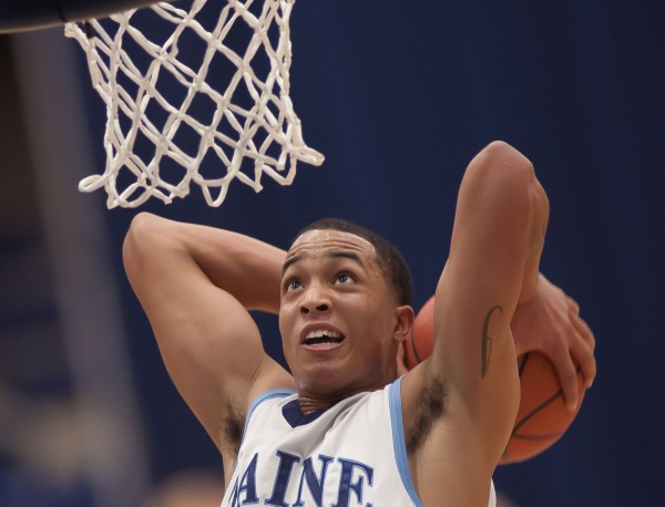 UMaine basketball player Justin Edwards slams the ball through the hoop for two points in the second half of their game against the UMBC Retrievers on Saturday, Jan. 5, 2013, in Orono.