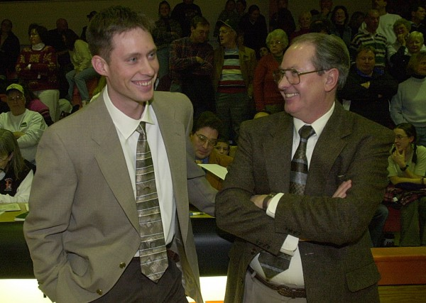 Brewer coach Mark Reed (left) and his father, Bangor coach Roger Reed, talk shop just before their teams' game in January 2001. Roger Reed is now assisting Mark, who is the head coach of the Hermon boys basketball team.