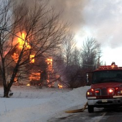 Crews battle building fire at Indian Township