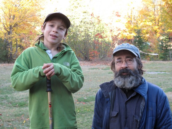Asher Molyneaux, 8, and his father, Paul Molyneaux, pose for a photo after completing their hike on the Appalachian Trail in October 2010.
