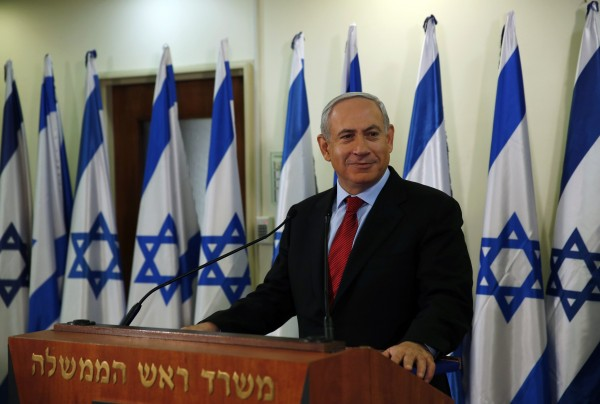 Israel's Prime Minister Benjamin Netanyahu pauses while delivering a statement at his office in Jerusalem on Wednesday, Jan. 23, 2013. Netanyahu narrowly won an election in which disgruntled voters catapulted a new centrist challenger into second place and he now faces the daunting task of building a coalition.