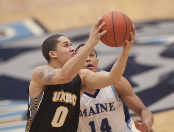 UMBC Men's basketball player Aaron Morgan (0) drives to the hoop past Maine player Justin Edwards (14) in the first half of a NCAA college basketball game in Orono on Saturday, Jan. 5, 2013.