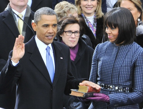 President Barack Obama is sworn-in for a second term by Supreme Court Chief Justice John Roberts during Obama's public inauguration ceremony at the Capitol in Washington, D.C. on Monday, Jan. 21, 2013. Michelle Obama holds two bibles, one owned by former President Abraham Lincoln, the other by Martin Luther King Jr.