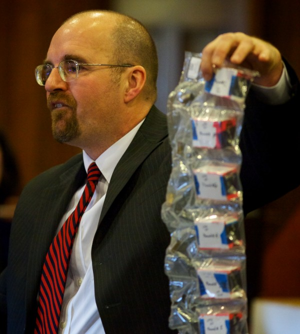 Assistant Attorney General Donald Macomber holds a bag of spent shell casings found at the scene of the crime as he presents his opening arguments in the Joel Hayden double murder trial in Cumberland County Superior Court in Portland Monday, Jan. 7, 2013.