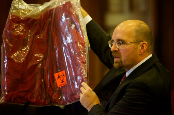 Assistant Attorney General Donald Macomber holds up a pair of shorts, worn by the defendant, he said had traces of the victim's blood as he presents his opening arguments in the Joel Hayden double murder trial in Portland Monday, Jan. 7, 2013.