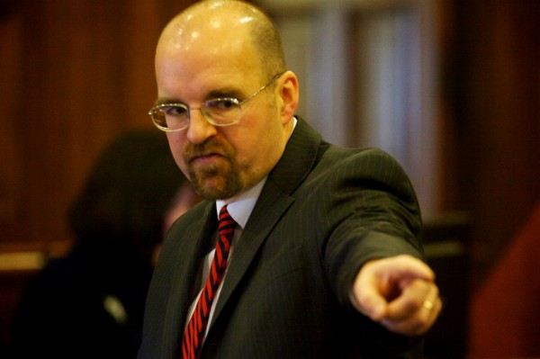 Assistant Attorney Donald Macomber points at the defendant as he presents his opening arguments in the Joel Hayden double murder trial in Portland Monday, Jan. 7, 2013.