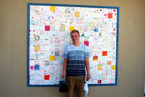 Ryan Andresen stands in front of a wall hanging named &quotTolerance Wall&quot which was part of his Eagle Scout project in this October 2012 handout photo in Moraga, California and provided courtesy of the Change.org Jan. 28, 2013. A review board for a California chapter of the Boy Scouts of America is challenging the national organization by recommending that the openly gay former Scout be awarded the top rank of Eagle.
