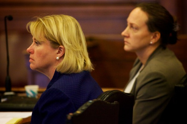 Assistant Attorney General Lisa Marchese (left) and Maine State Police Detective Ethel Ross listen to opening arguments in the Joel Hayden double murder trial in Portland Monday, Jan. 7, 2013.