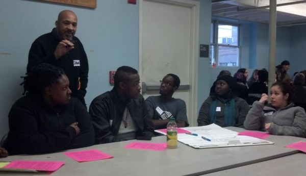 NAACP volunteer Dawud Ummah speaks in a discussion of homelessness issues with students attending the Jan. 12, 2013, Martin Luther King Jr. Day public forum on race and poverty.
