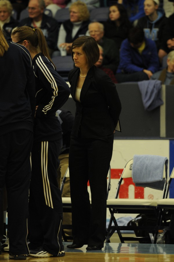 Tracy Guerrette of the University of Maine listens in on a team huddle during a 2012 game in Orono. The former Black Bears player has left her position as the director of basketball operations to pursue a religious vocation in the Catholic church.
