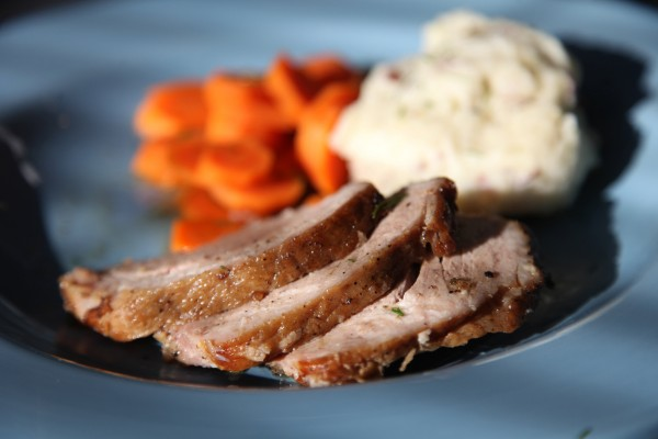 Pork roast with herb crust and sherry pan sauce is an easy and warmly satisfying meal.