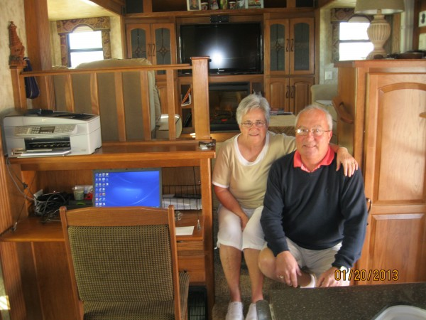 Donna and George, comfortable in their &quotrolling home,&quot a fifth wheel RV that hitches to the bed of their pickup truck.