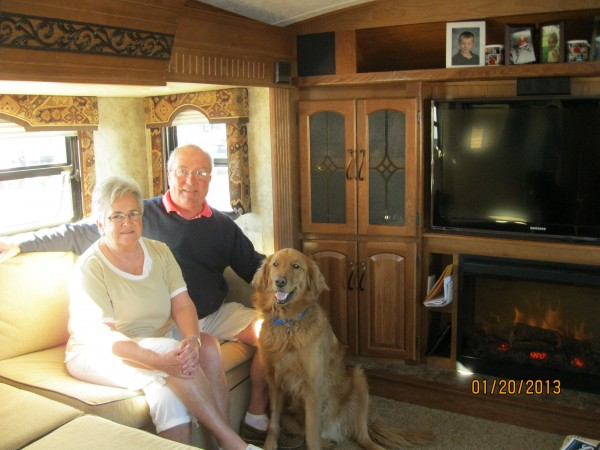 Donna and George sit with their dog, Captain, in their &quotrolling home,&quot a fifth wheel RV that hitches to the bed of their pickup truck.