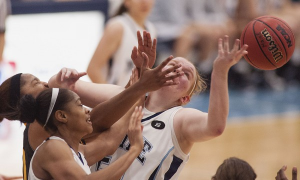 Maine women's basketball players Anna Heise (50) and Corinne Wellington (34)  contest a rebound with Virginia Commonwealth player Shekinah Henry in the first half of their college basketball game in Orono, Maine, Saturday, November 24, 2012.