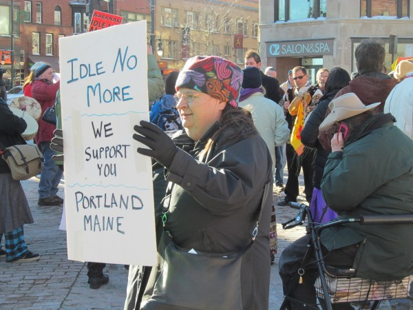 Karen Demers of Brunswick holds a sign at an Idle No More rally on Saturday, Jan. 5, 2013, in Portland. The rally was held to show solidarity with indigenous people worldwide.