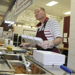 "Ed Clement has been serving lunch at Bangor High School for four years. Lunches ""are getting much healthier,"" says Clement. The nutritional value of school lunches in the Bangor school system has changed and improved over the last five years by adding whole grains, salad bars, and more fruits and vegetables to the menu."