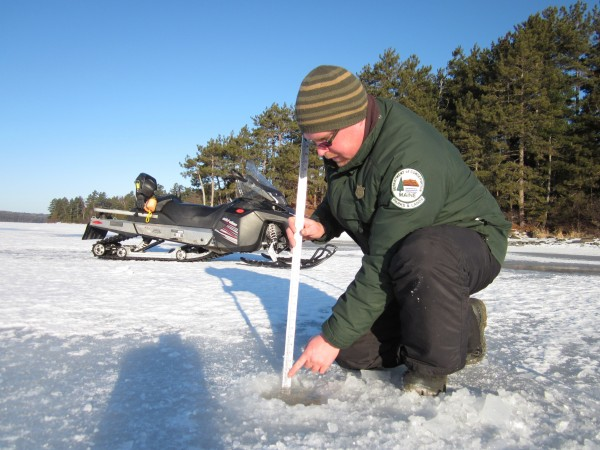 Ranger Chris Silsbee checks the ice on Telos Lake recently.