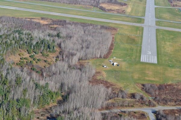 This aerial photo taken Saturday, Nov. 17, 2012 shows the proximity of the wreckage of a plane that crashed Friday, Nov. 16, 2012 killing three, to the Knox County Regional Airport.