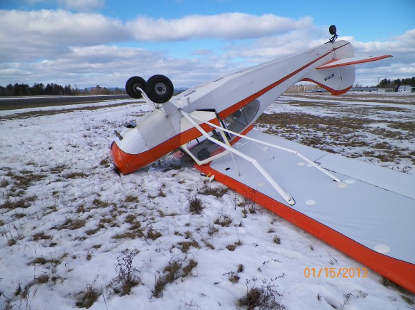 A plane sits on its wings after flipping over while its pilot was practicing landings in Norridgewock on Tuesday.